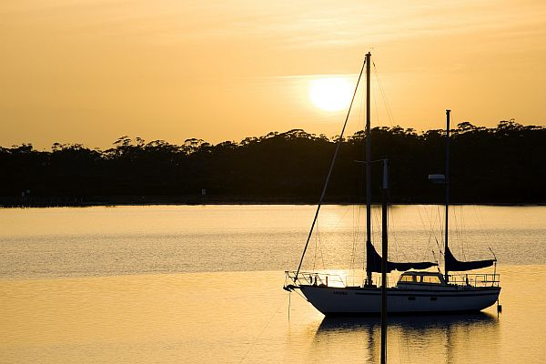 Yacht moored at Metung at sunset