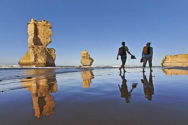 Couple hike past the Twelve Apostles
