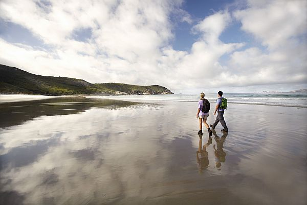 Couple walking along beach in Wilsons Promontory National Park