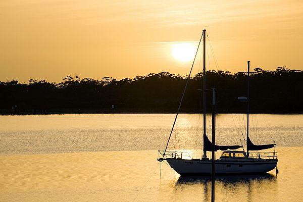 Yacht moored at Metung at sunset