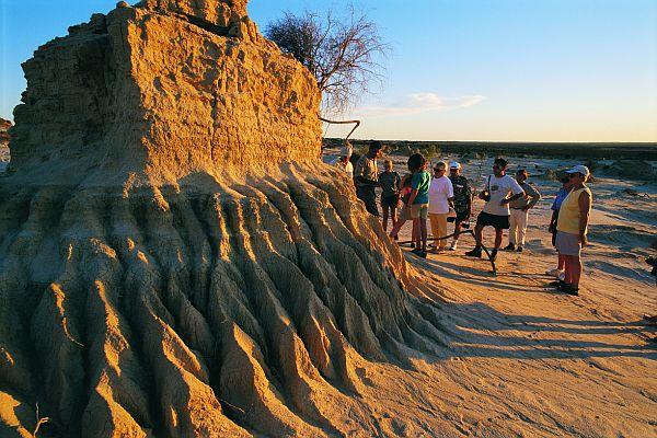 Tourists examine termite hill at Mungo National Park